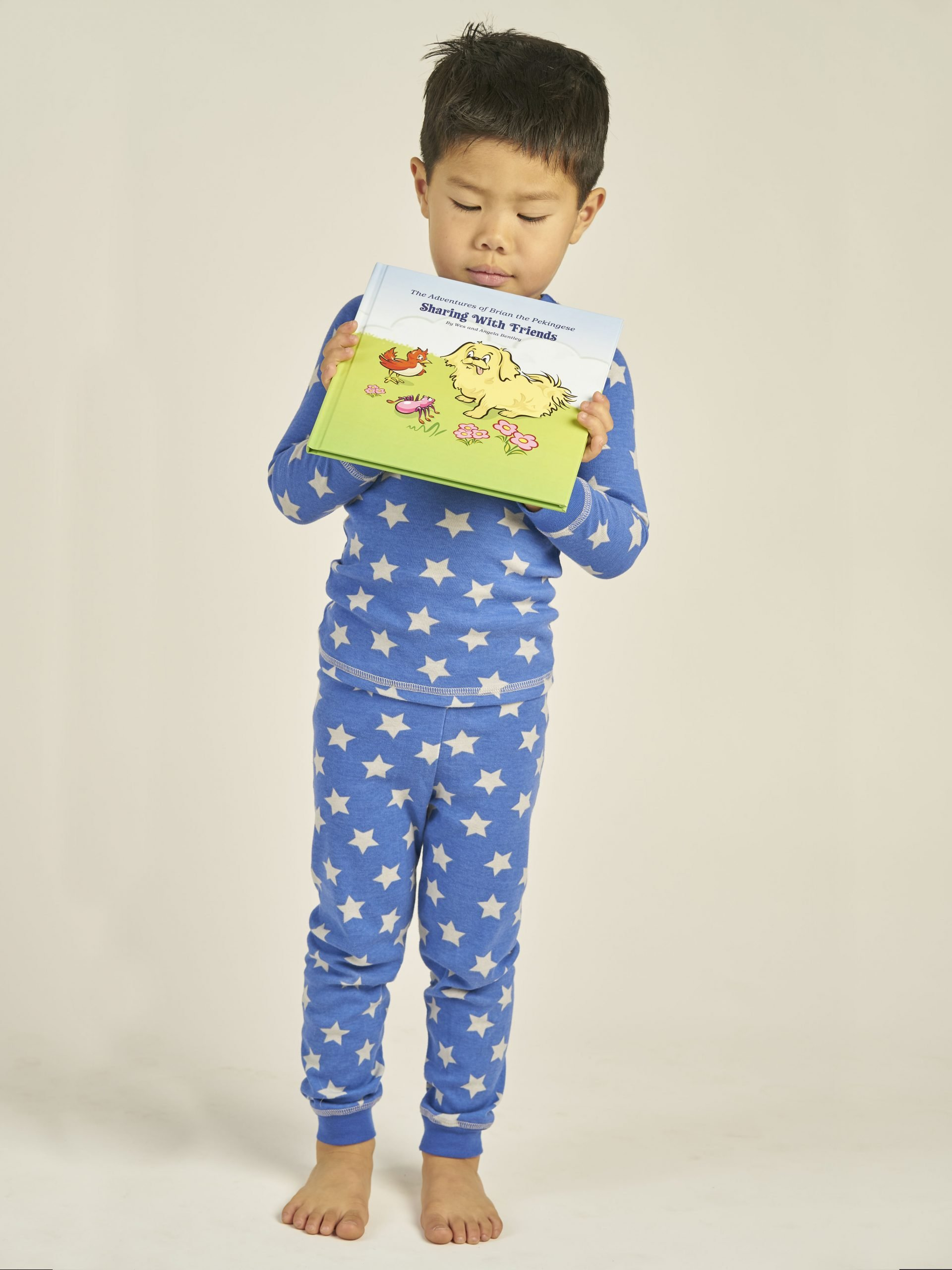Child holding a children's bedtime storybook