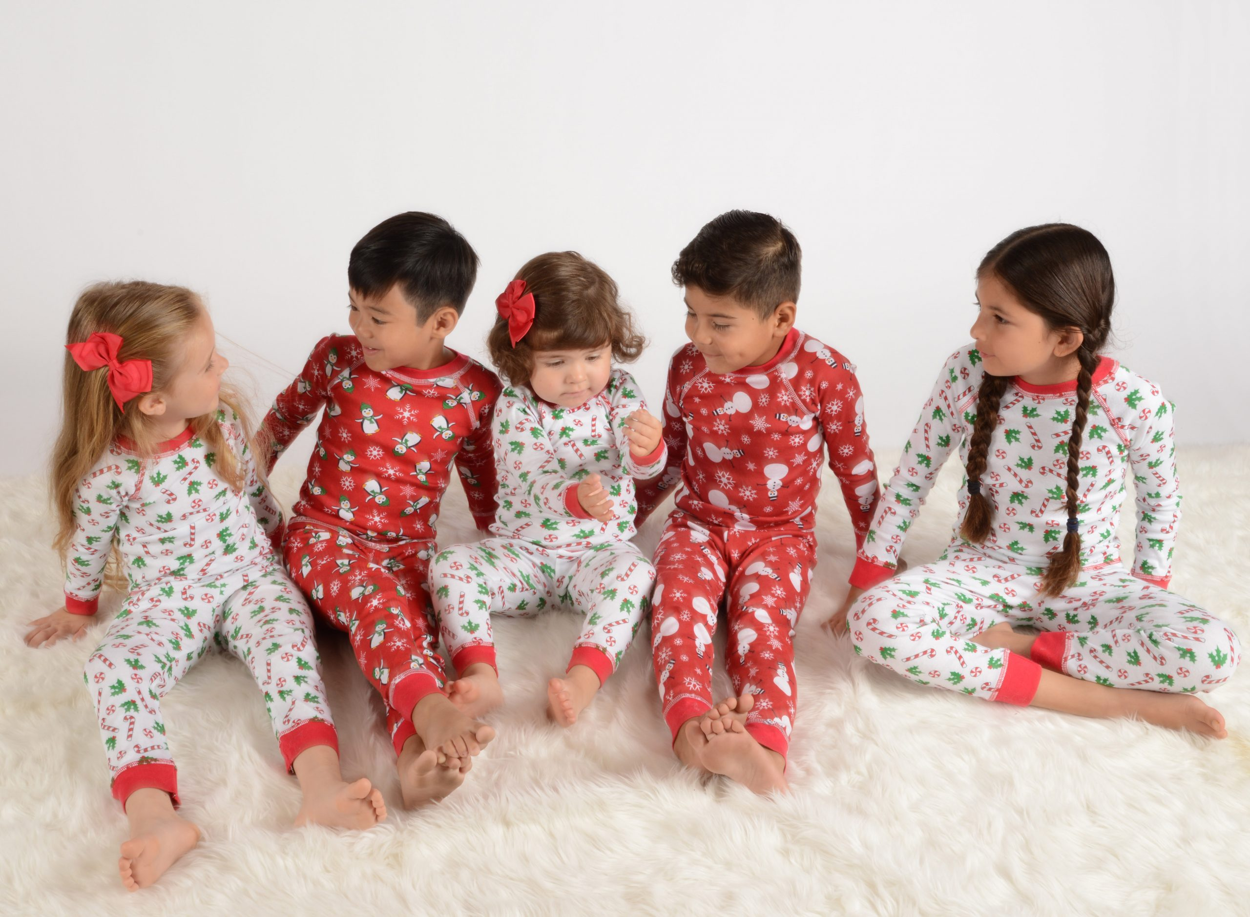 boys and girls wearing holiday pajamas
