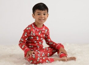 boy wearing penguin print pajamas