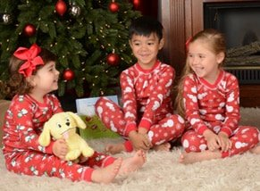 boy and girls wearing holiday pajamas