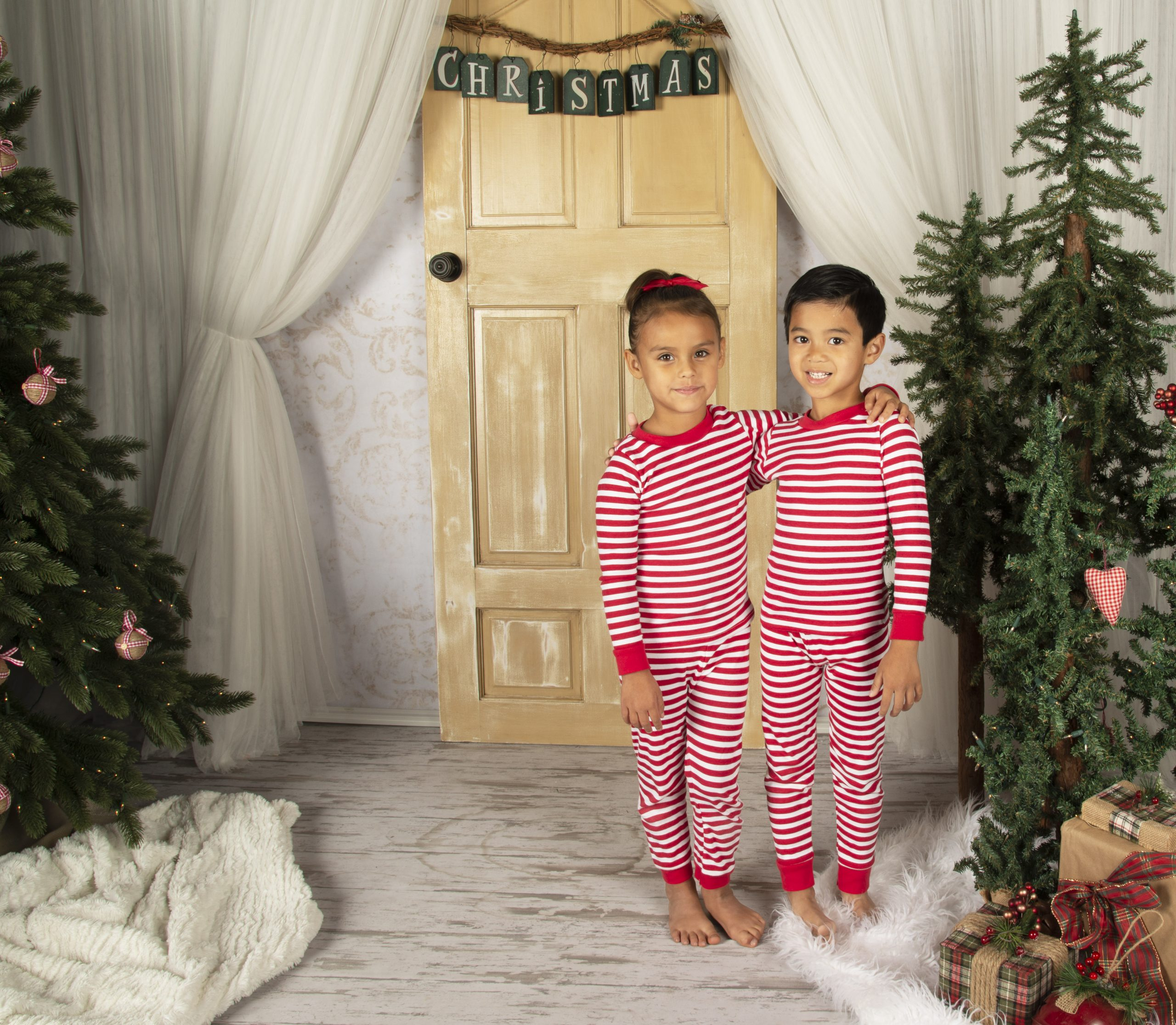 boy and girl wearing stripe print long sleeve pajamas
