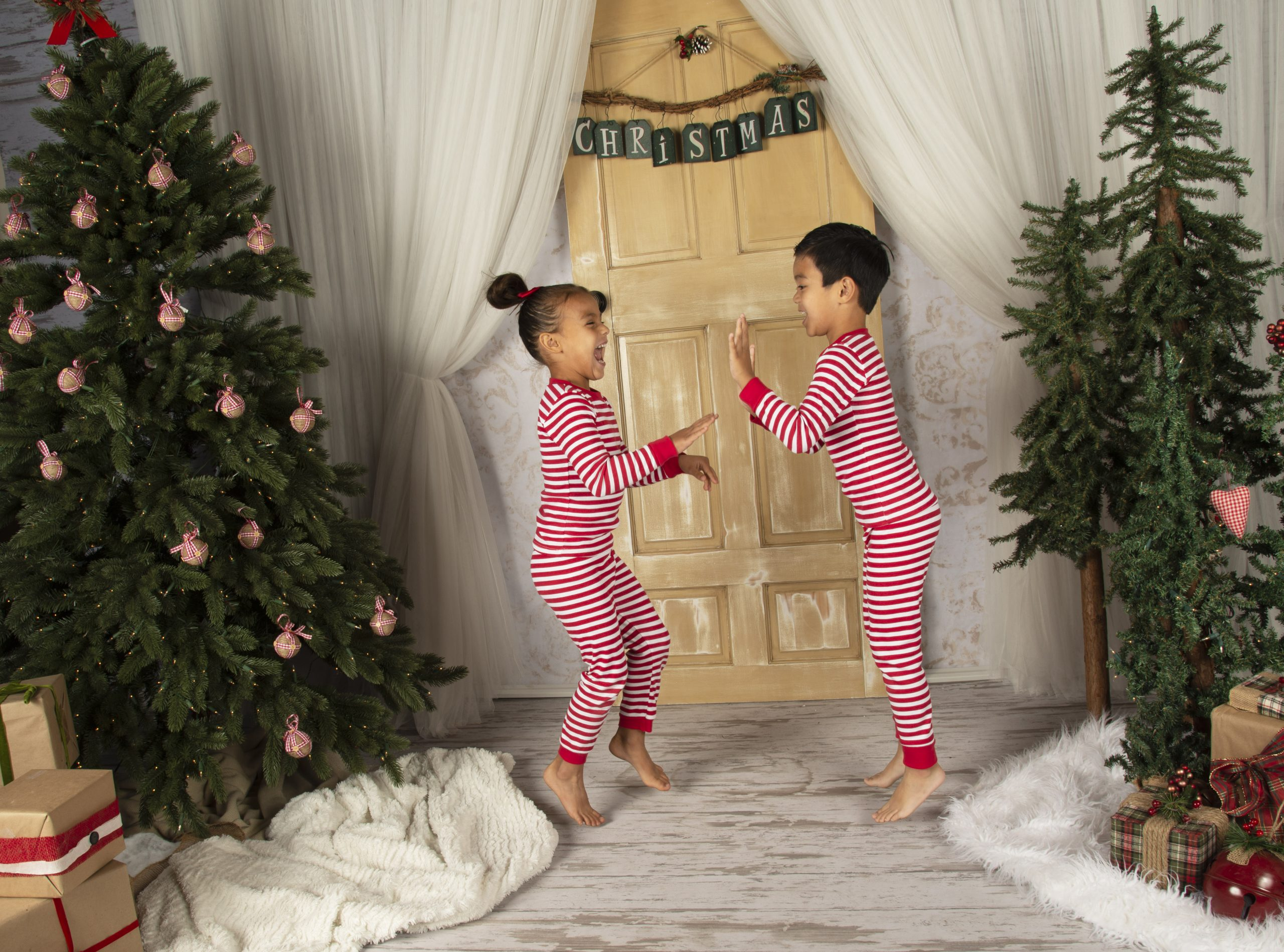 Children wearing organic stipe print pajamas