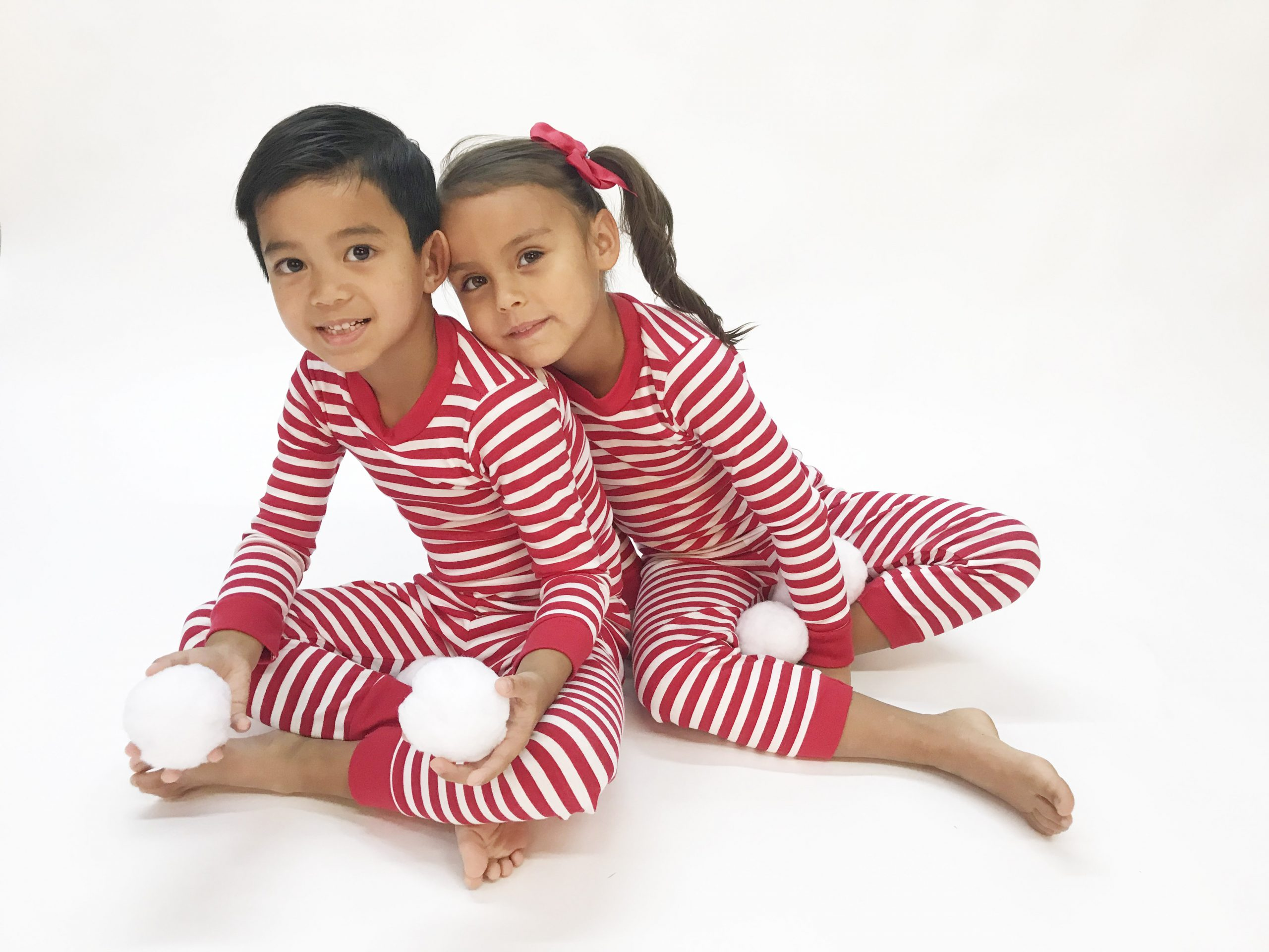 boy and girl wearing long sleeve stripe print pajamas