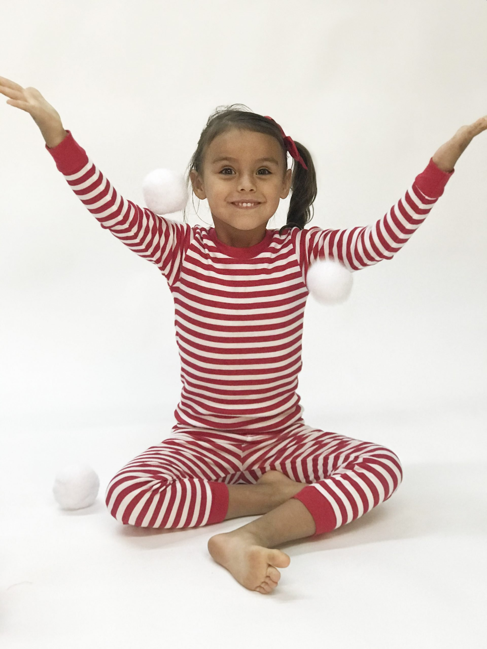 girl wearing stripe print pajamas with cotton balls