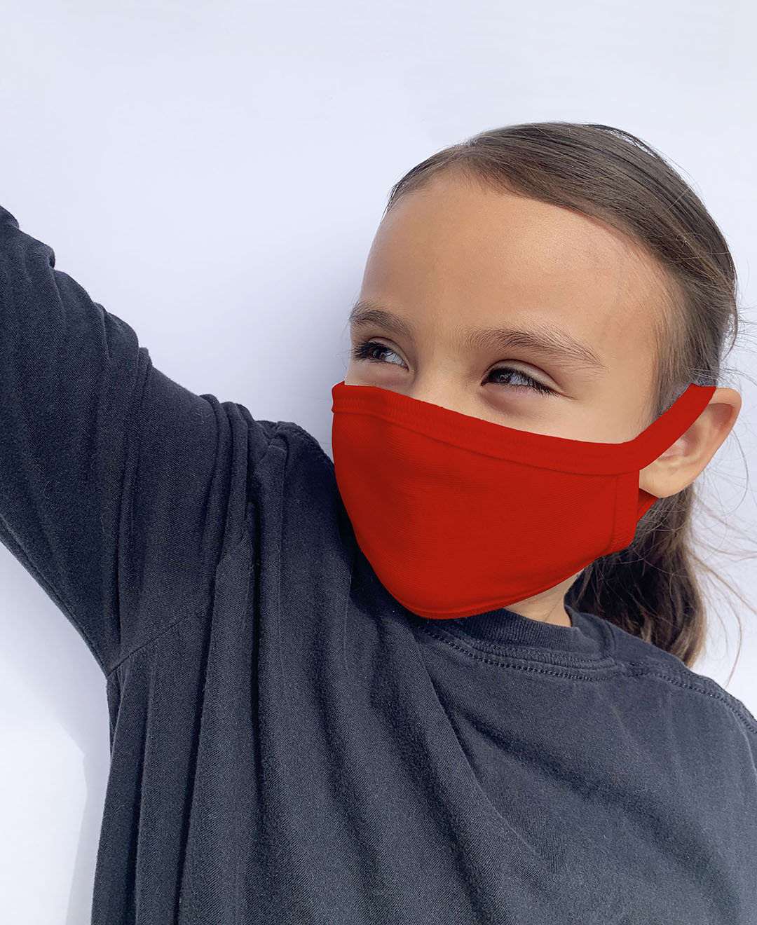child wearing red face mask