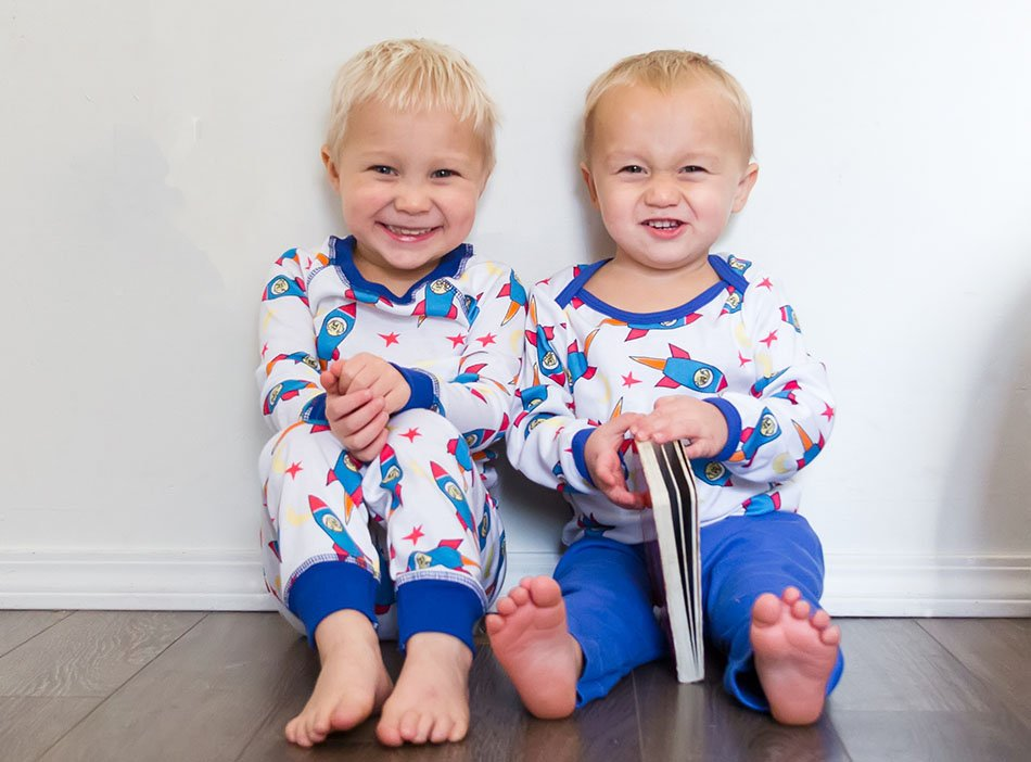 boys wearing pajamas with rocket print