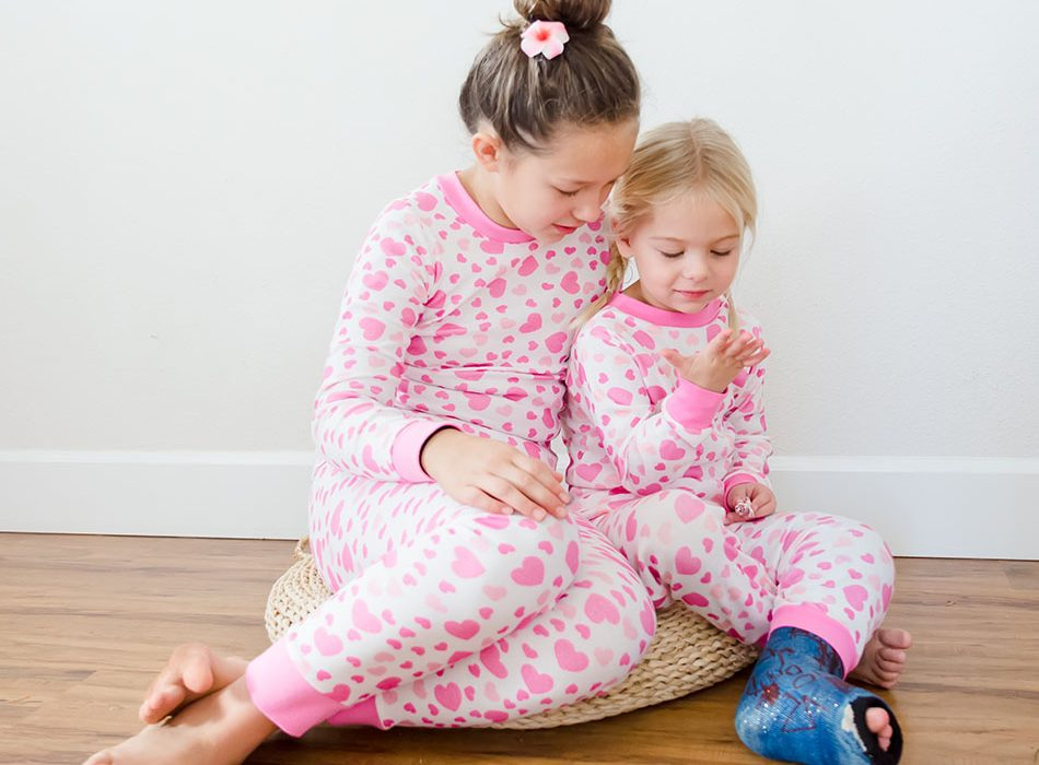 girls wearing pajamas with heart print