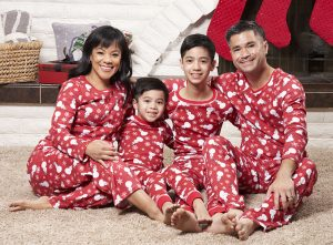 family wearing snowman print pajamas for Christmas in July promotion