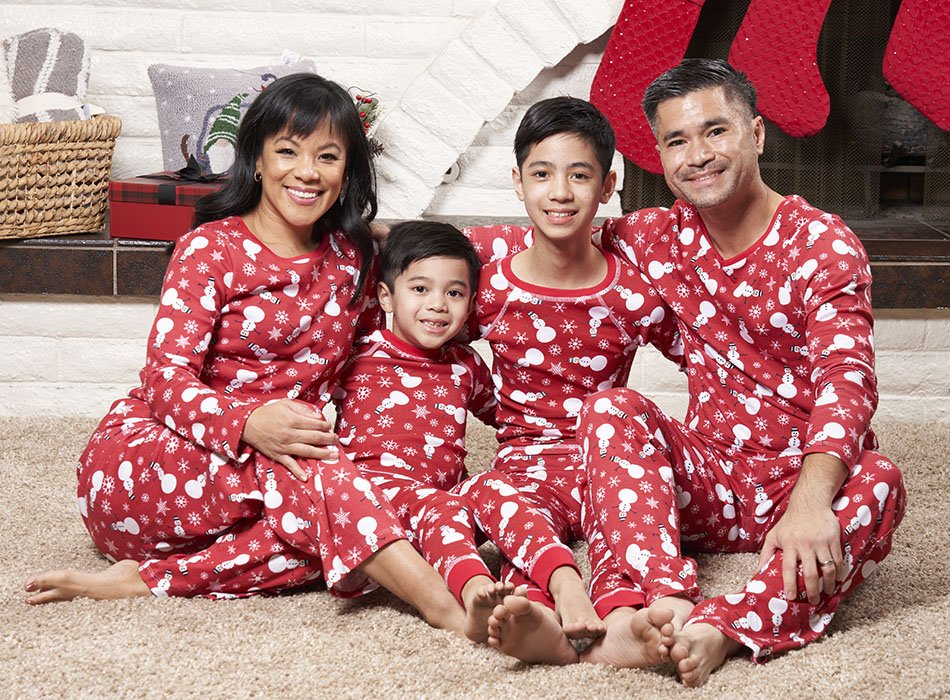 family wearing snowman print pajamas
