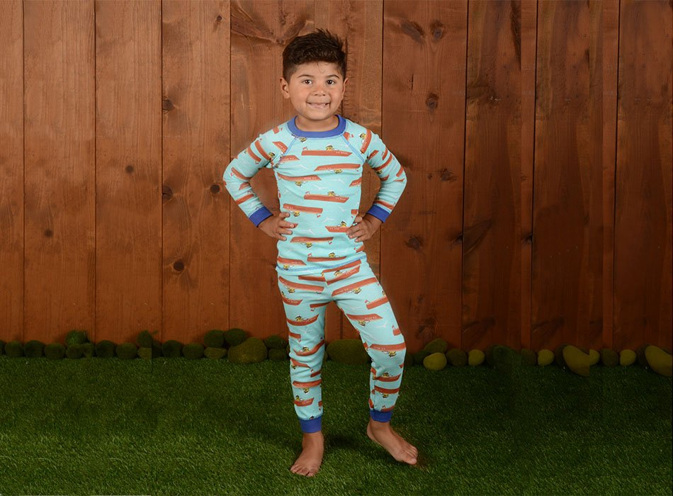 boy wearing pajamas with boat print